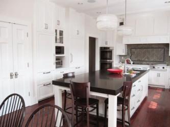 White kitchen brown chairs