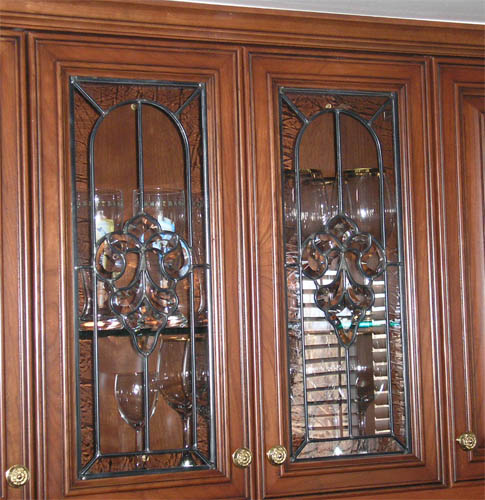 Clear stained glass cabinet doors spotlats for Beveled glass kitchen cabinets
