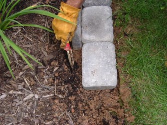 Edging A Flower Bed With Cement Pavers